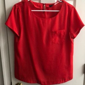 Red short sleeve blouse with front left pocket